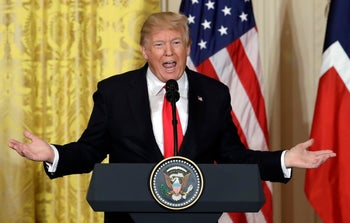 U.S. President Donald Trump speaks during a news conference at the White House in Washington, January 10, 2018.