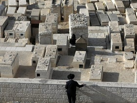 Ultra-Orthodox man stands at a Jewish cemetery on the Mount of Olives near Jerusalem's Old City.