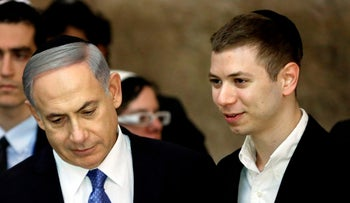 Prime Minister Benjamin Netanyahu along with his son Yair, who was recorded in a controversial tape that caused a public outcry recently.