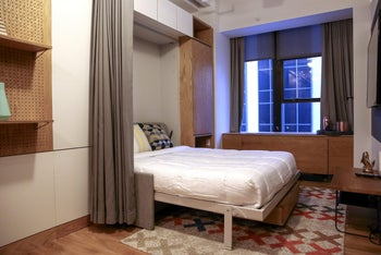 A murphy bed is seen in a studio apartment at the WeLive building in New York, U.S., on October 31, 2017.