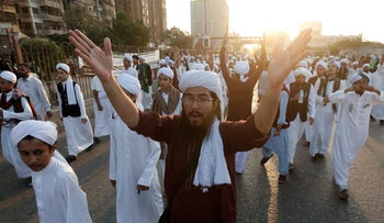 Muslims chant slogans as they take part in a procession to mark Eid-e-Milad-un-Nabi, the birthday of Islam's Prophet Mohammad, in Karachi, Pakistan December 1, 2017.
