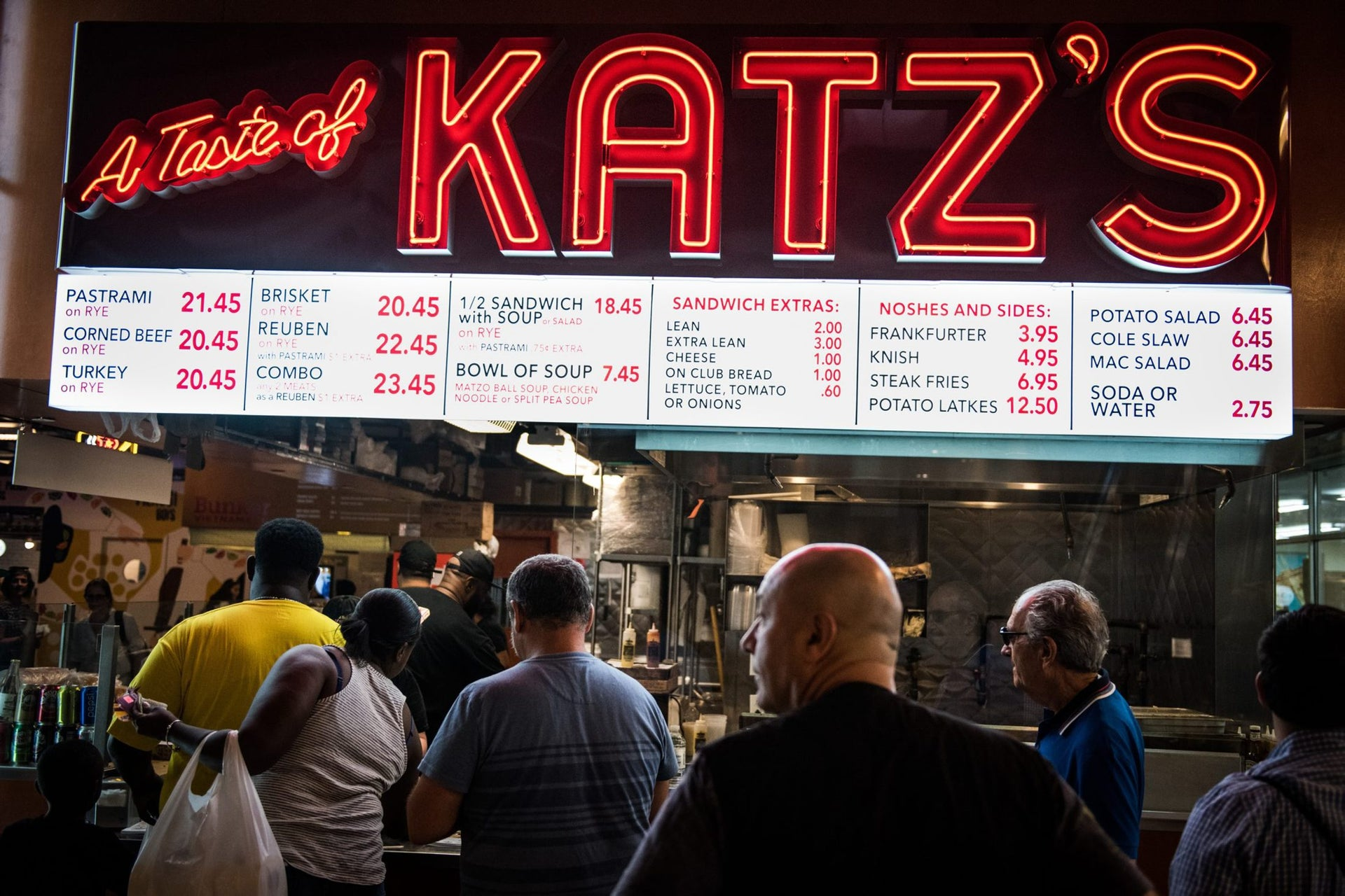 Customers wait in line to order from A Taste of Katz's deli inside DeKalb Market Hall at City Point in the Brooklyn borough of New York.