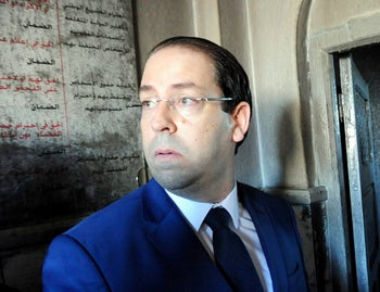 Tunisian Prime Minister Youssef Chahed visits a sacked police station in El Battan, 35 kms west of Tunis, Tunisia, Wednesday Jan. 10, 2018.