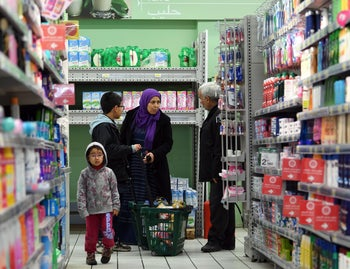 Tunisians shop at a Carrefour supermarket in a neighbourhood in the locality of Ben Arous, near the Tunisian capital Tunis, on January 10, 2018, after it was burgled the previous night