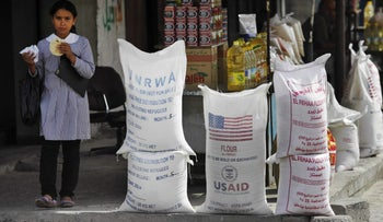 File photo: Sacks of flour, some part of humanitarian aid by UNRWA and USAID, but now offered for sale by a vendor, sit outside a food store in Gaza City.