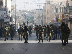 Israeli soldiers deploy following a protest against U.S. President Donald Trump's decision to recognize Jerusalem as lsrael's capital, Hebron, Friday, Dec. 15, 2017.