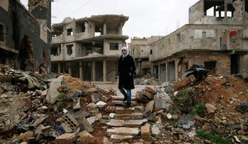 Sumaya Bairuty walks to her parents house in war-damaged Homs, Syria on January 17, 2018.
