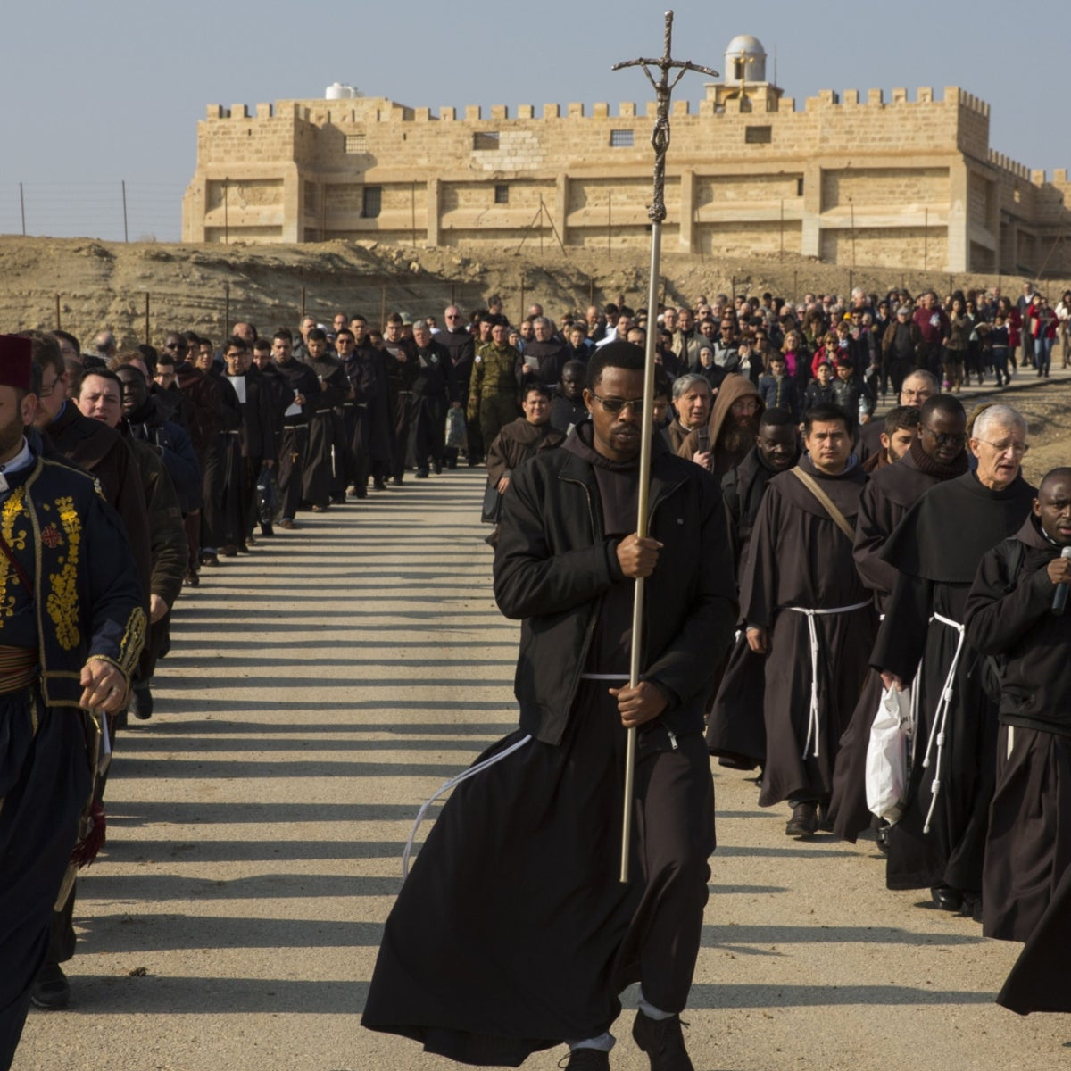 Franciscan pilgrams from Italy, France and Israel make their way from the monastery of John the Baptist to the Jordan River, January 14, 2018.