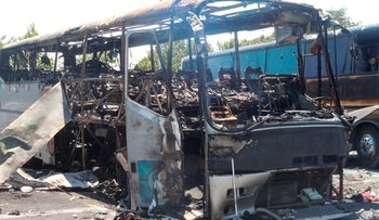 A bus that was damaged in a bomb blast seen outside Burgas Airport, Bulgaria, July 19, 2012.
