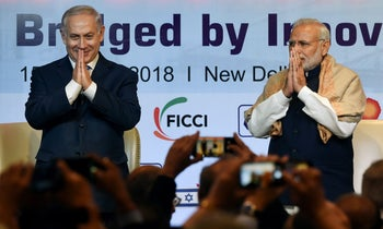 Indian Prime Minister Narendra Modi and Israeli Prime Minister Benjamin Netanyahu greet during the India-Israel Business Summit in New Delhi. January 15, 2018