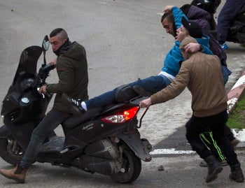 Palestinian youths evacuate a wounded comrade during clashes with Israeli forces in Jenin, in the north of the occupied West Bank, on January 18, 2018.