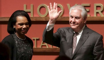 Secretary of State Rex Tillerson, right, waves after speaking to the Hoover Institution at Stanford University with former Secretary of State Condoleeza Rice, left, in Stanford, Calif., Wednesday, Jan. 17, 2018