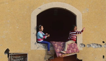 Palestinian girls play at their family's house in Khan Younis, Gaza. March 10, 2015