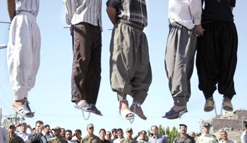 A public hanging of five convicted criminals in Mashhad, Iran, August 1, 2007.