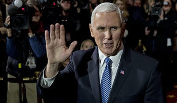 U.S. Vice President Mike Pence waves to photographers in Washington, D.C, U.S., on Wednesday, Jan. 3, 2018.