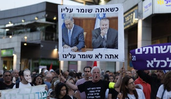 'When you protect him, you're not protecting us,' reads sign with image of Prime Minister Benjamin Netanyahu and Attorney General Avichai Mendelblit during anti-government corruption protest in Israel