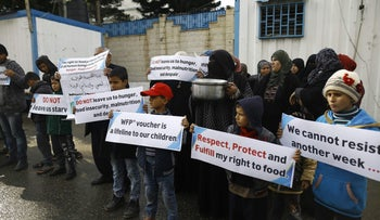 Palestinians take part in a protest against aid cuts outside of United Nations' offices in Gaza City on January 17.