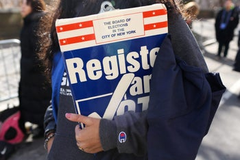 A woman holds a clipboard to register people to vote at Women's March in Manhattan in New York City, New York, U.S., January 20, 2018