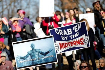 People participate in the Second Annual Women's March in Washington, U.S. January 20, 2018