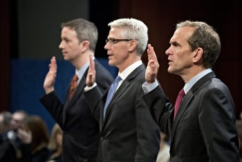 Kent Walker, vice president and general counsel with Google Inc., from right, Colin Stretch, general counsel with Facebook Inc., and Sean Edgett, acting general counsel with Twitter Inc., swear in to a House Intelligence Committee hearing in Washington, D.C., U.S., on Wednesday, Nov. 1, 2017.