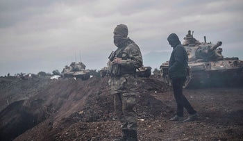 Turkish army soldiers wait near the border before entering Syria, on January 21, 2018 at Hassa, in the Turkish province of Hatay, near the Syrian border