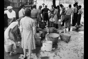 Jerusalem residents standing in line to get buckets of water during the siege on the city in 1948.