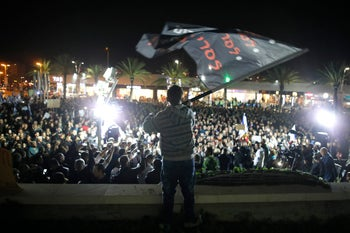 Some two thousand people demonstrate in the city of Ashdod to protest plan to close businesses on Shabbat after the Knesset passed the 'Supermarkets Law.'