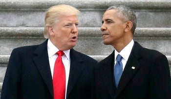 U.S. President Donald Trump talking with former President Barack Obama on Capitol Hill in Washington, January 2017.