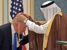 Trump receiving the Order of Abdulaziz al-Saud medal from Saudi Arabia's King Salman bin Abdulaziz al-Saud at the Saudi Royal Court in Riyadh, May 20, 2017.