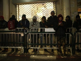 Asylum seekers wait in line at the ministry of interior office in south Tel Aviv, January 7, 2018
