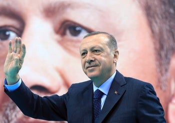 Turkey's President Recep Tayyip Erdogan waves to supporters of his ruling Justice and Development Party (AKP), at a rally in Elazig, eastern Turkey. Jan. 13, 2018