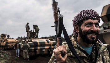 Free Syrian army tanks gather close to the border on January 21, 2018 at Hassa, in Hatay province