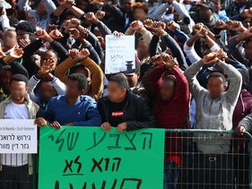 Thousands of asylum seekers protest Israel's efforts to deport them to Rwanda and Uganda on January 22, 2018 outside the Rwandan embassy.