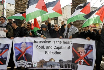 Palestinians shout slogans as they demonstrate against U.S. Vice President Mike Pence's visit to Israel. Nablus, in the Israeli occupied West Bank. January 22, 2018