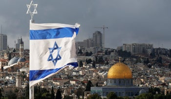 A photo showing an Israeli flag near the Dome of the Rock and the Old City in Jerusalem