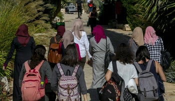 Women walk on campus at Hebrew University in Jerusalem on the first day of the school year, October 22, 2017.
