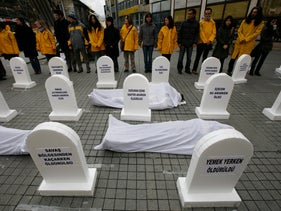 Members of Amnesty International stage a silent protest against Israel's attacks on Gaza, near the main Taksim Square in central Istanbul January 17, 2009.