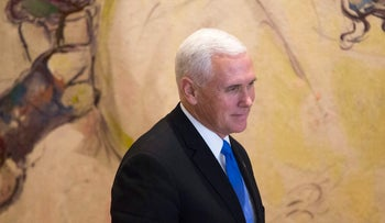 U.S. Vice President Mike Pence stands after signing the guest book in Israel's parliament in Jerusalem, January 22, 2018.