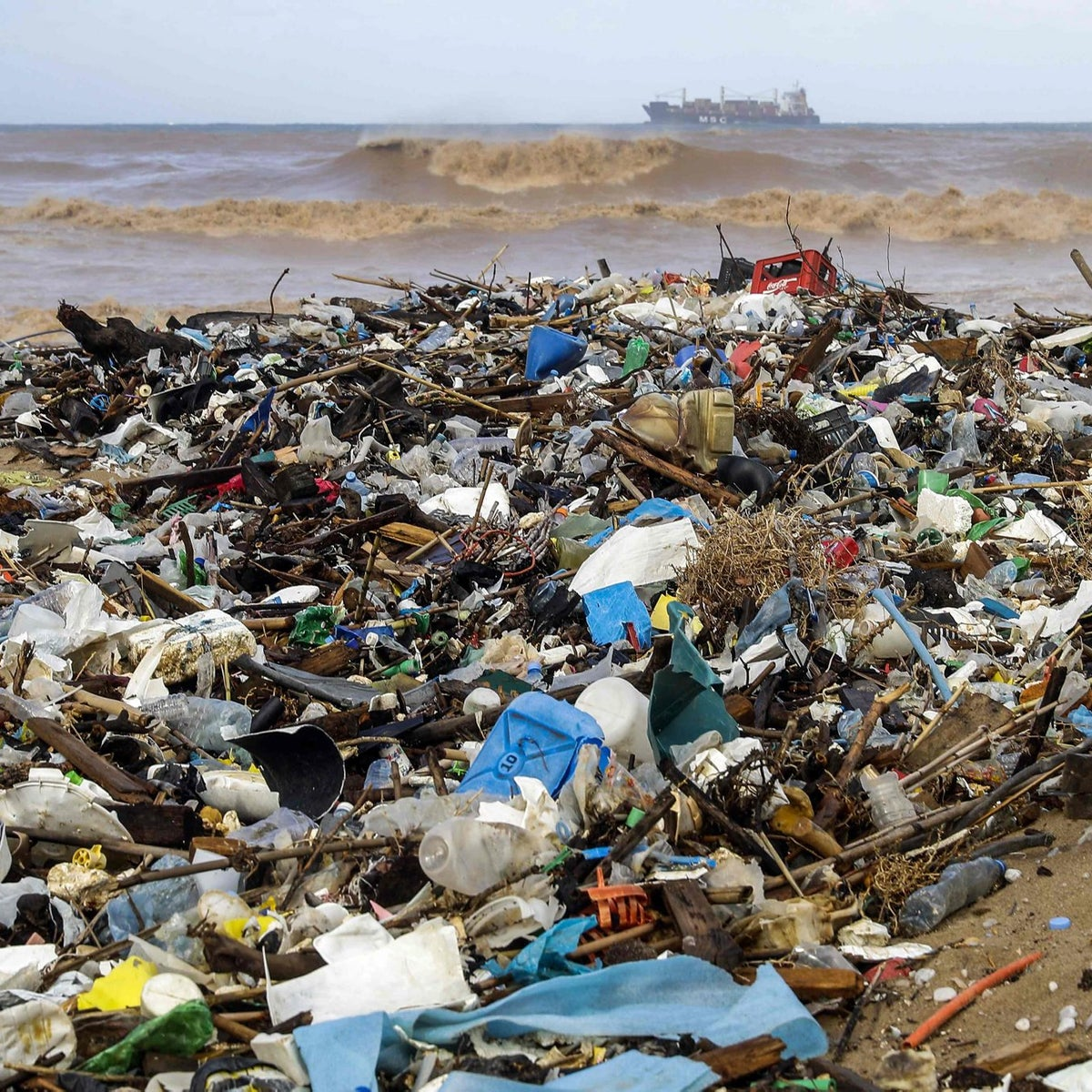 A picture taken on January 23, 2018 shows a view of the beach of the coastal town of Zouk Mosbeh, north of Beirut, covered with garbage and waste that washed and piled along the shore after stormy weather.