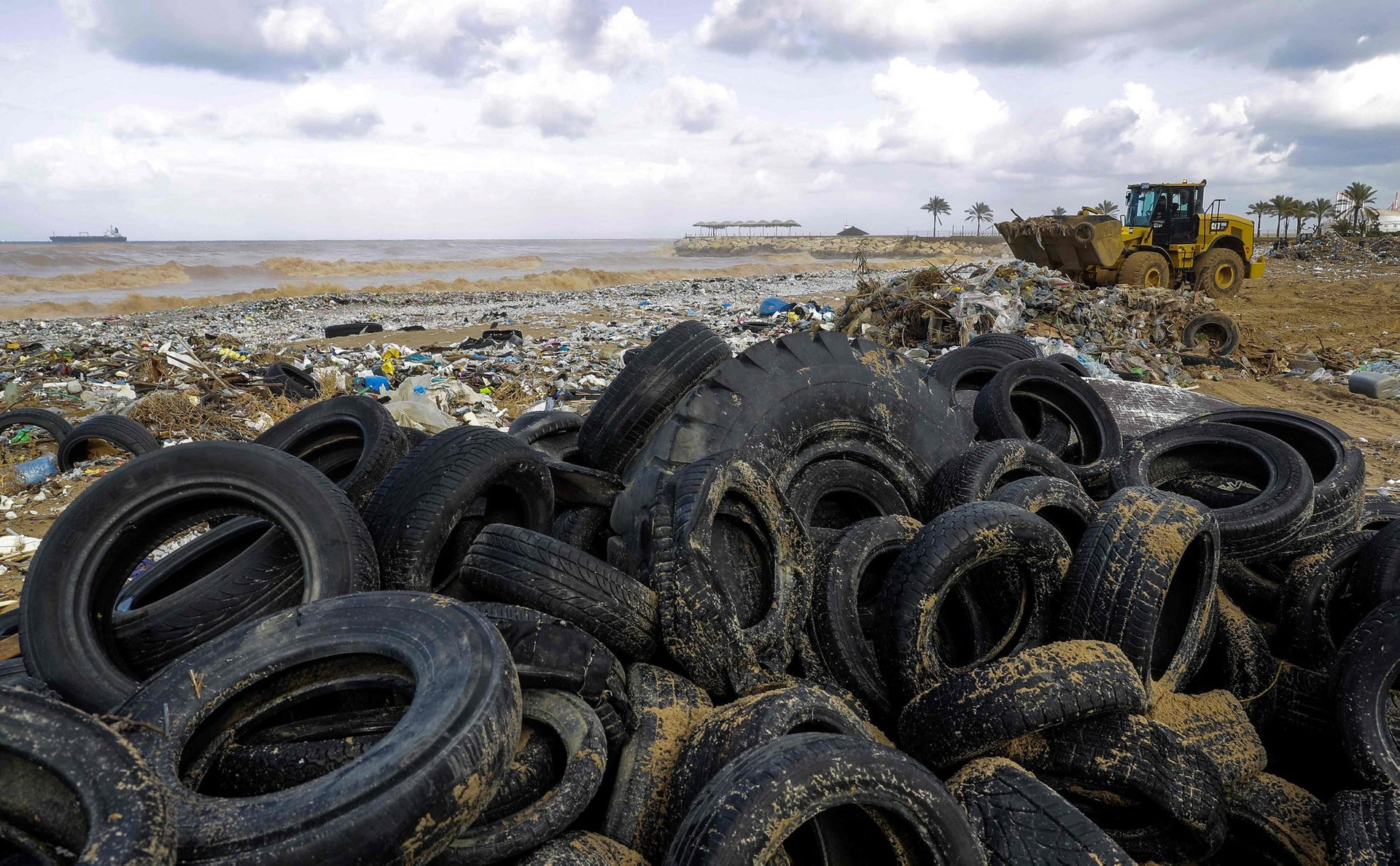 A picture taken on January 23, 2018 shows tires piled up on the beach of the coastal town of Zouk Mosbeh, north of Beirut, as garbage and waste cover the area after having washed and piled along the shore following stormy weather.