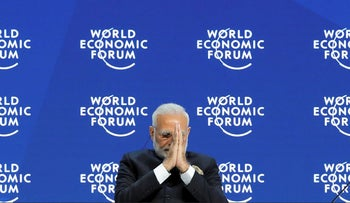 India's Prime Minister Narendra Modi gestures as he attends the Opening Plenary during the World Economic Forum (WEF) annual meeting in Davos, Switzerland, January 23, 2018