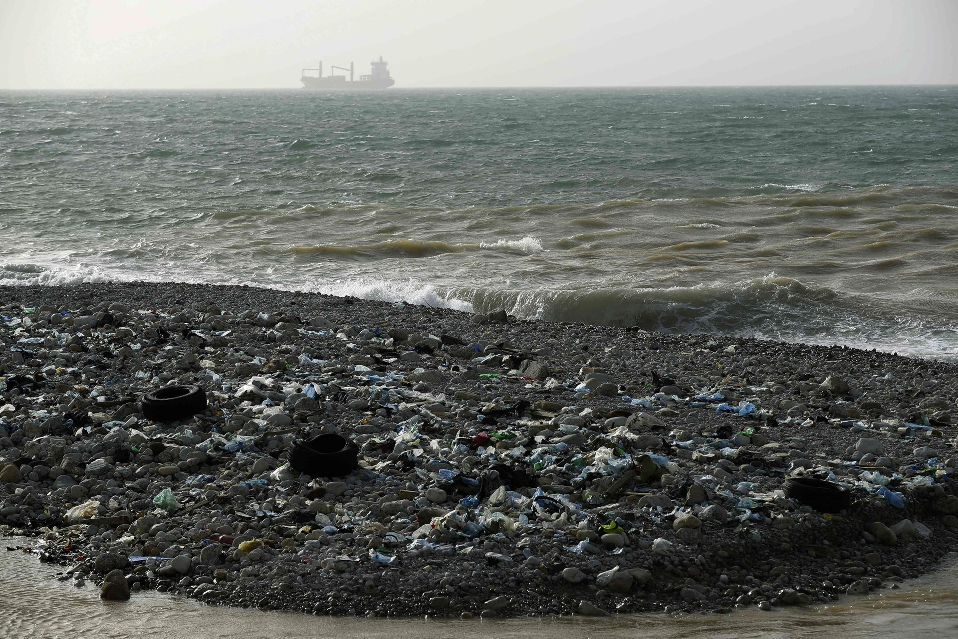 Garbage litters the shore of Zouk Mikael, north of the Lebanese capital Beirut, on January 22, 2018.