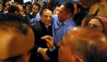 Egypt's former army chief of staff, Sami Anan, leaves a news conference at his office in Cairo.