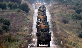 A convoy of Turkish Army armoured personnel carriers led by a tank are driven toward the border with Syria, in the outskirts of Hassa, Turkey, Tuesday, Jan. 23, 2018.