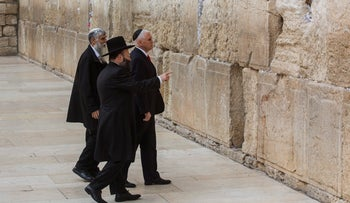 An image showing U.S. Vice President Mike Pence approaching the Western Wall, accompanied by Western Wall Rabbi Shmuel Rabinowitz