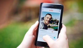 File: A Tinder profile on an iPhone 6. Israeli tech firm finds the dating app lacks standard encryption, leaving users exposed.