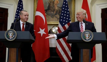 File photo: U.S. President Donald Trump reaches to shake hands with Turkey's President Recep Tayyip Erdogan in the White House in Washington, D.C. following their meeting in May 2017.