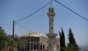 A mosque with a loudspeaker on its minaret in Maghar, 2017.