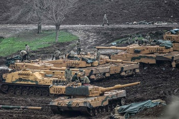 "Turkish tanks near the Syrian border at Hassa on January 24, 2018, as part of the operation ""Olive Branch.'"
