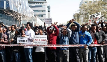 Asylum seekers from Eritrea protest outside the Rwandan Embassy in Israel, January 22, 2018.